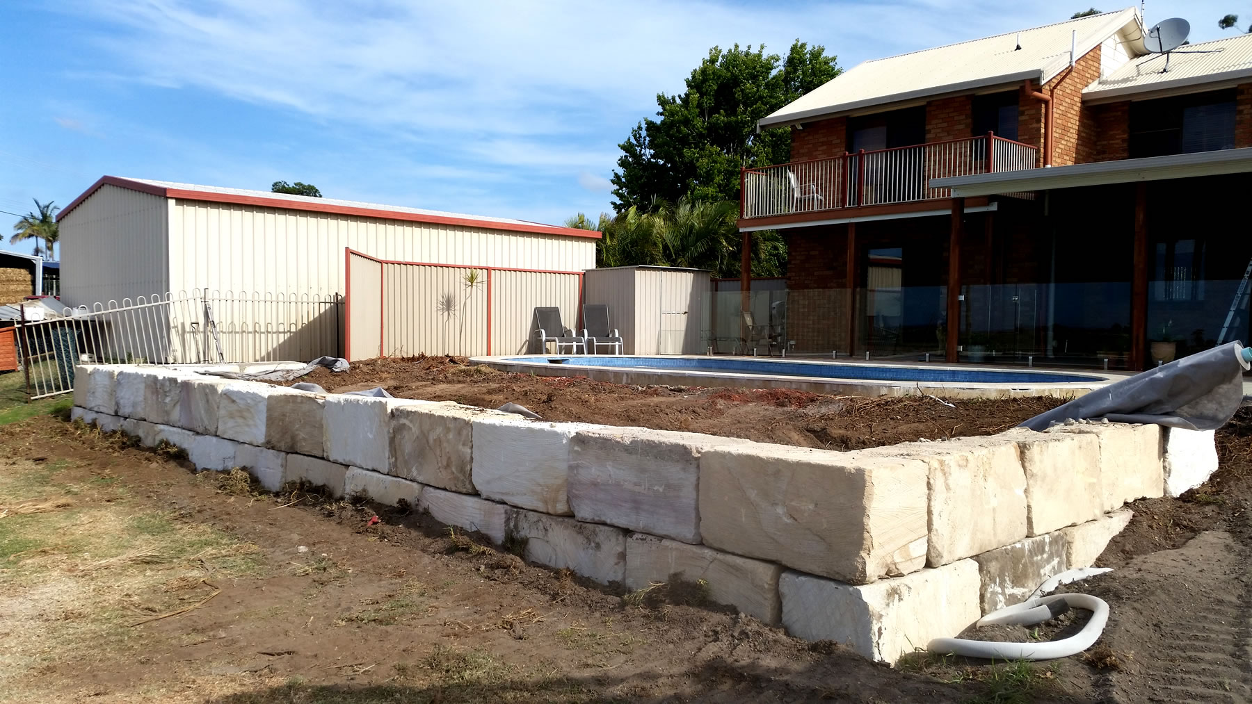 A-grade sandstone wall swimming pool surround gold coast